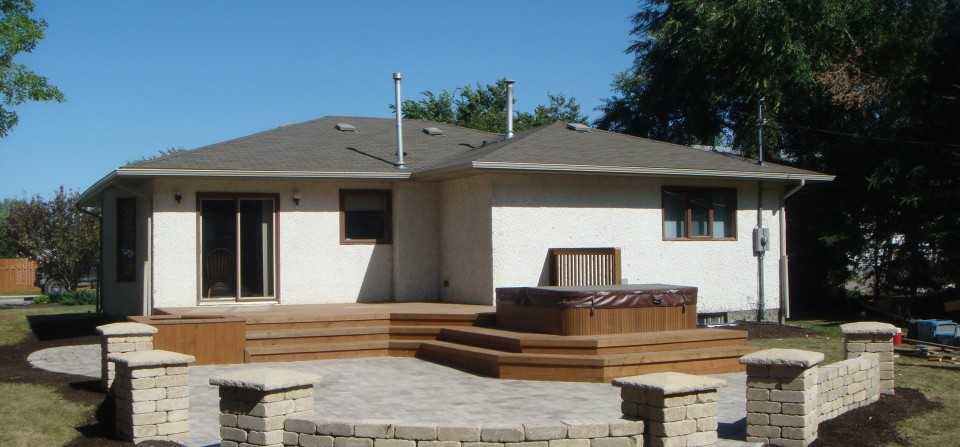 Landscaping Features: Deck, Patio and Retaining Wall