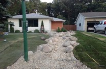 Landscaping Challenges in Winnipeg? Dry Stream Bed Grading Solution