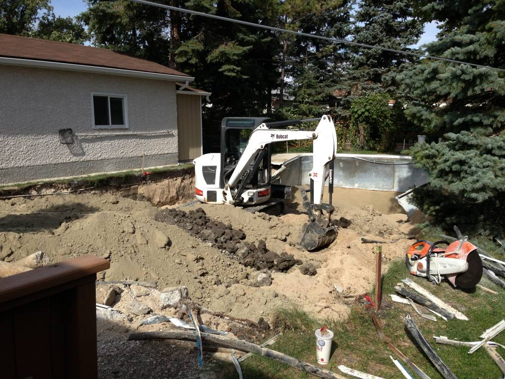 Backyard renovation — Step 1:  remove swimming pool