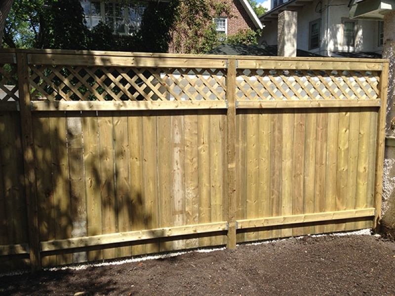 Treated green deck and fence with Holland paving stone patio in Antique Brown (AOW)
