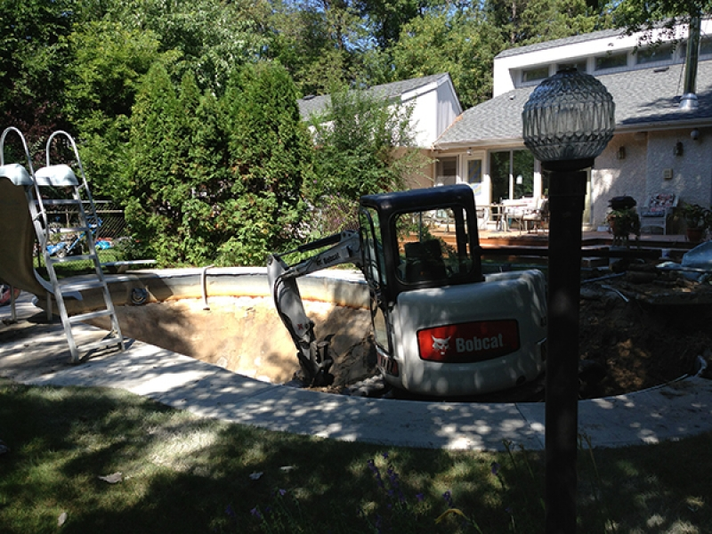 Swimming pool removal with large machine access