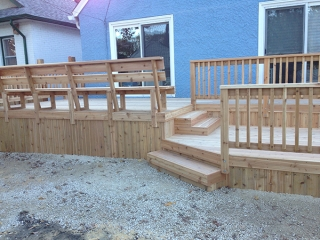 Two tier cedar deck with built-in benches