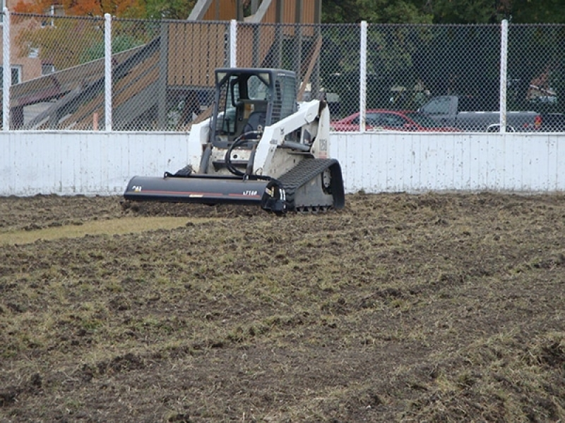 Re-grading and sodding inside a hockey rink