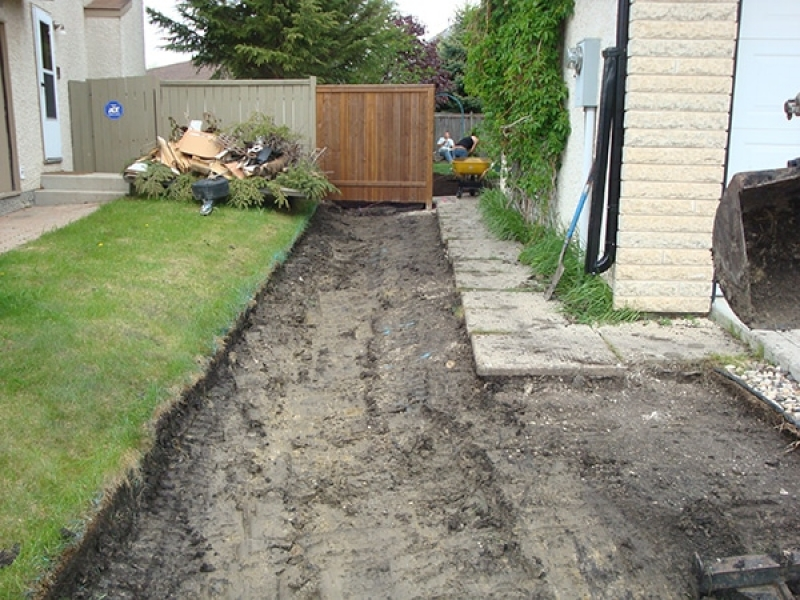 Regrading to improve drainage from back yard.