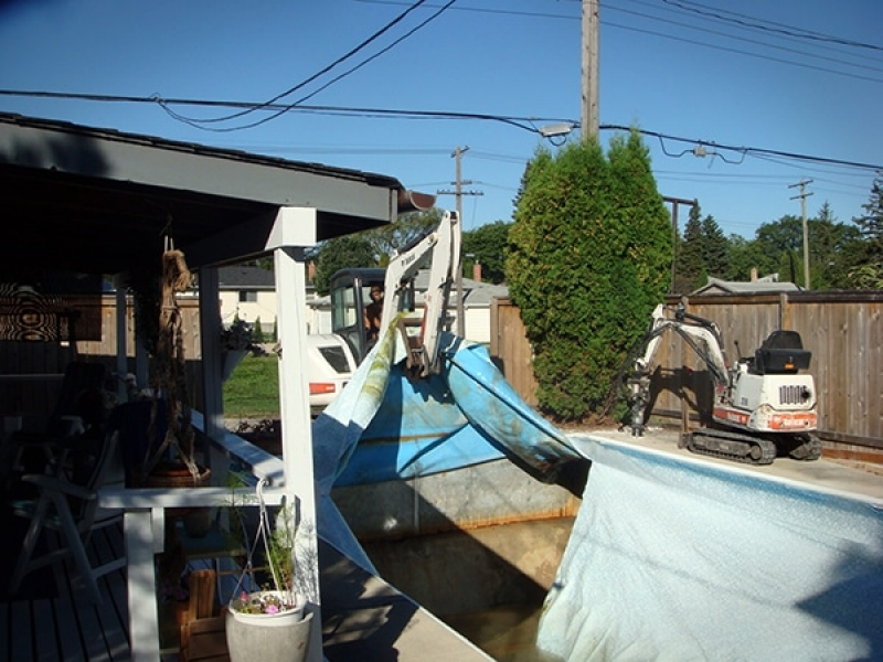 Swimming pool removal with access directly off back lane.