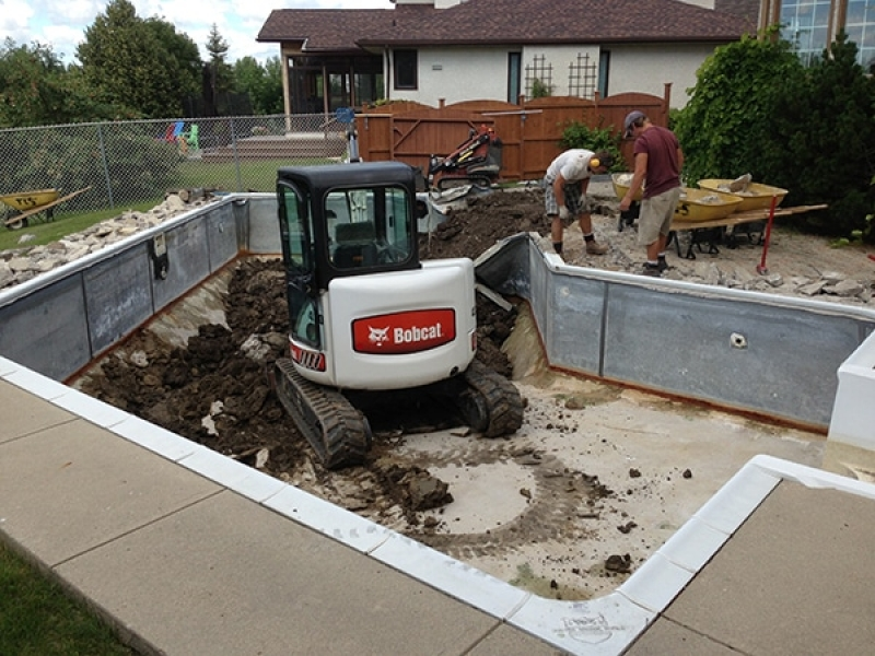 Swimming pool removal with access for larger machine.