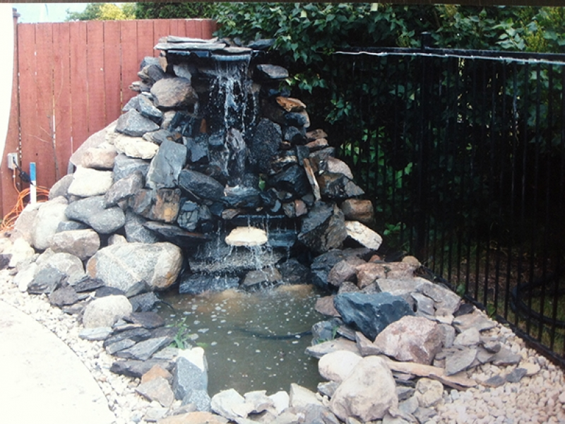 Tall custom waterfall built onto wooden substructure.