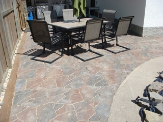 Flagstone pavers in Antique Brown used for walkways and around pool.