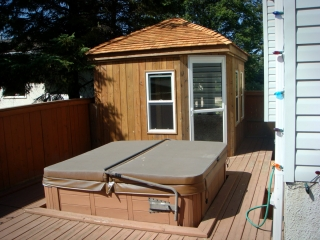 Gazebo and changeroom built onto deck with built-in hot tub