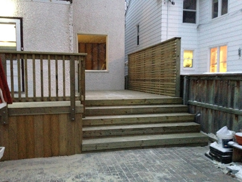 Treated green deck with privacy wall and piles for future hot tub enclosure
