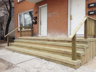 Large treated green front landing and stairs for duplex