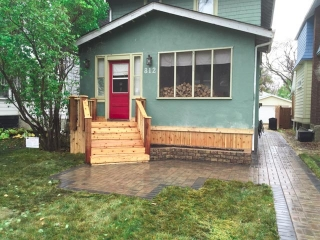 Piles under existing front porch, front steps, porch skirt, walk and front patio