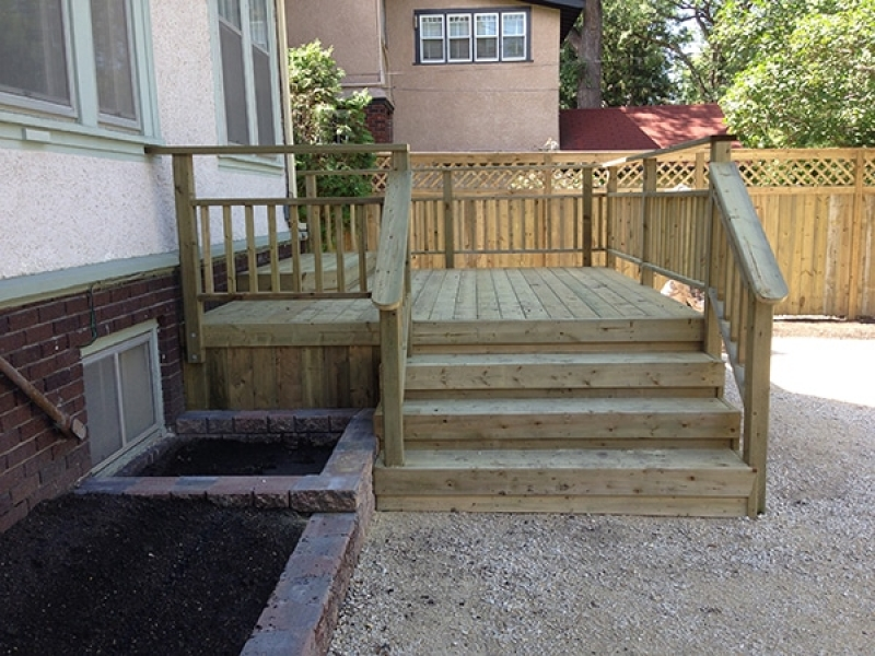 Treated green deck and fence, retaining wall planters, prep for future paving stones