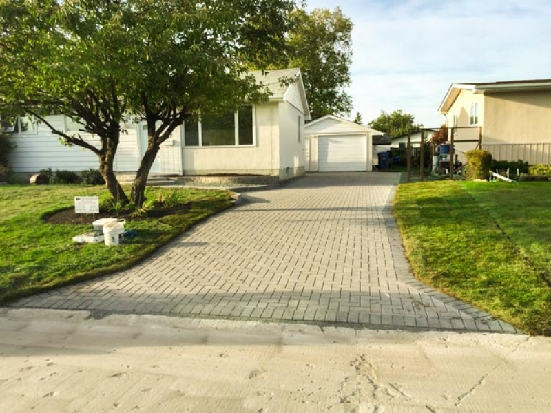 Driveway, patio, front walk, and stairs with Holland paving stones and Stack Stone retaining wall bricks