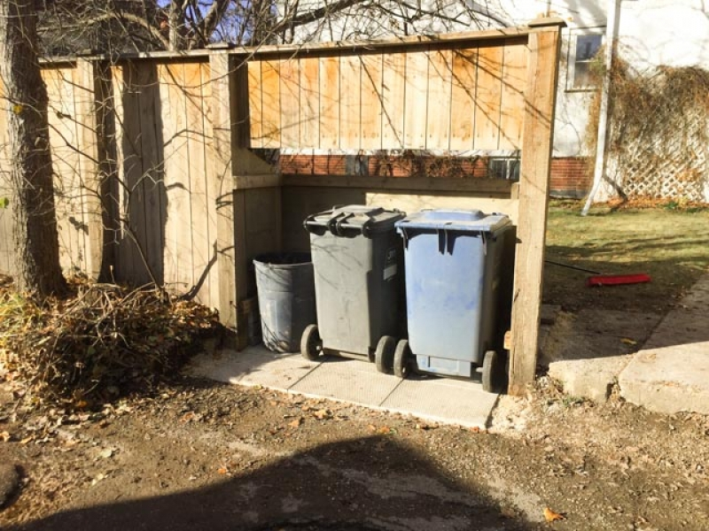 Garbage bin alcove in back lane fence