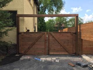 Treated brown swinging vehicle gate