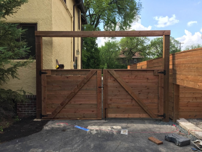Treated brown swinging vehicle gate