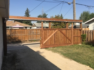 Treated brown sliding vehicle gate
