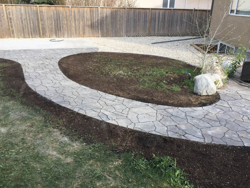 Swim spa pad, large window wells, re-grading, flagstone pathway, and decorative stone