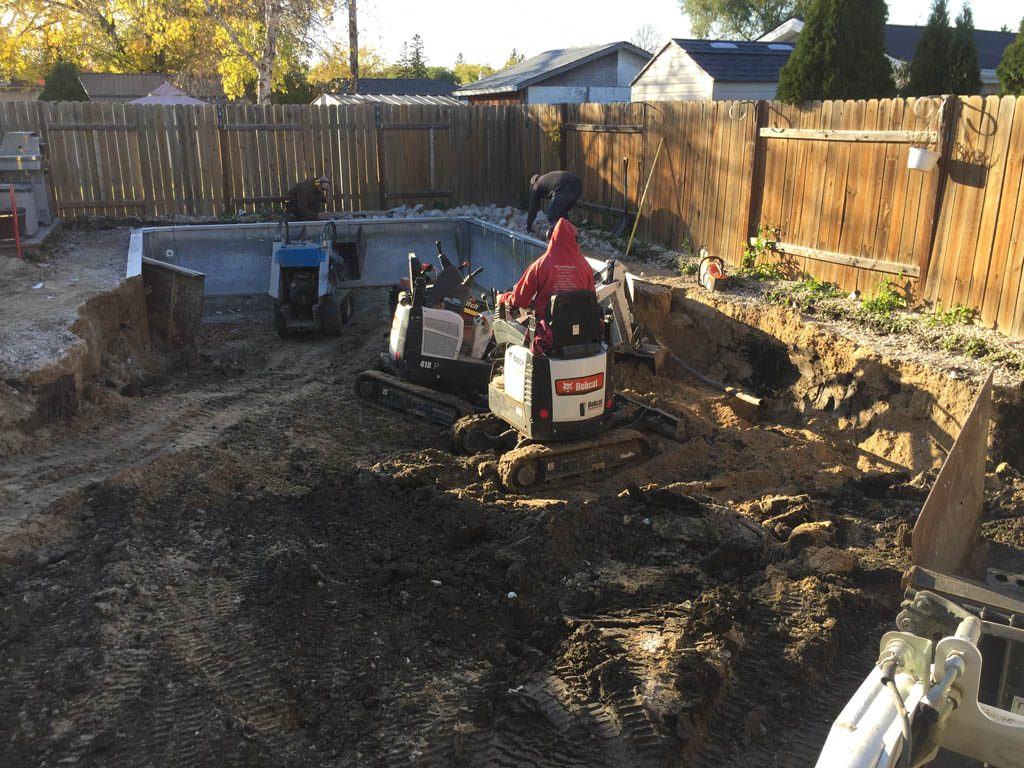 Swimming pool removal from back yard