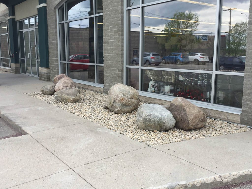 Boulders and riverwash for commercial building