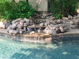 Waterfall into pool, boulders, Pisa II retaining wall,etc