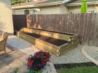 Two-tier wooden planter with treated green 4x4s