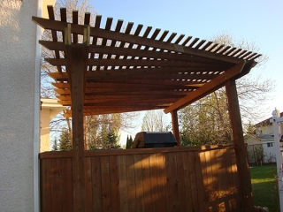 Treated brown deck with built-in cabinets, counters, benches, and pergola (Outdoor Wood Structure)
