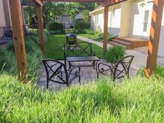Treated brown arbor with roman paving stone patio AOW