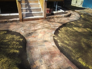 Curvy front walk with Roman paving stones in Antique Brown