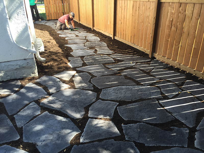 Path through garden with Grand Flagstone in Pacific Grey