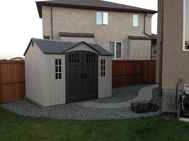 Verano paver walk from drive to back yard. Roman paver walk to shed. Vinyl shed on wood base
