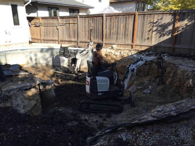 Removing concrete and steel walls from inground pool