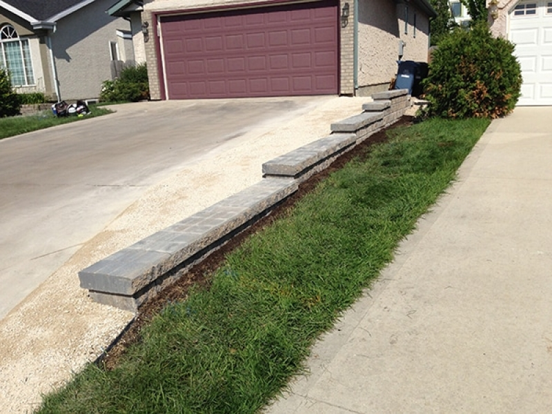 Pisa II retaining wall in Sierra Grey and crushed limestone to widen driveway