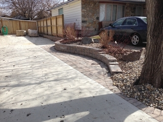 Custom privacy wall, patio extension, retaining wall beside driveway