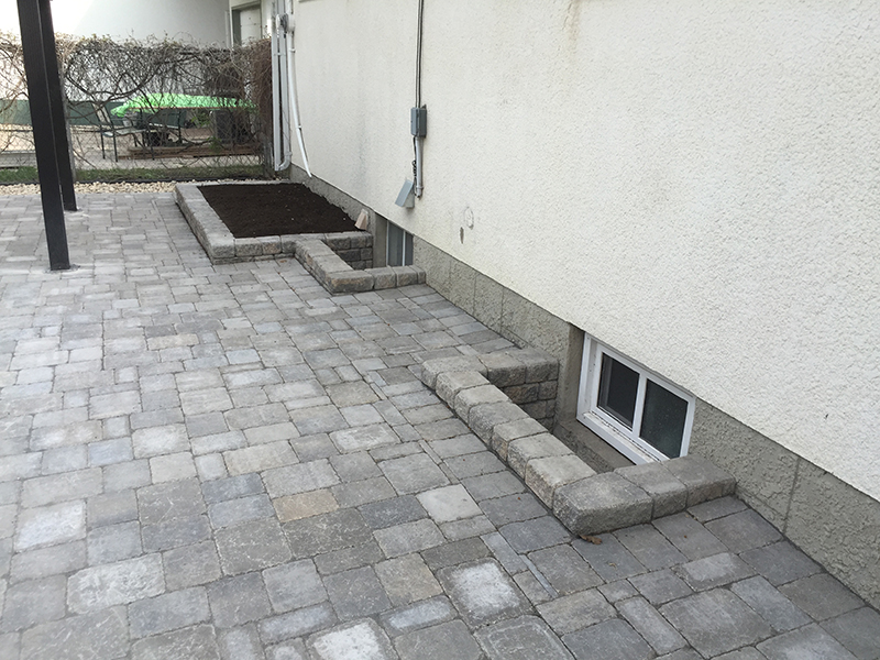 Roman Paver Patio And Window Wells The Lawn Salon