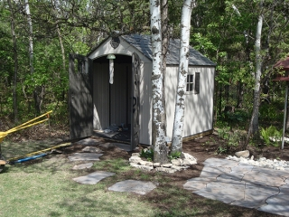 Backyard oasis with bridge, dry stream, dry waterfall, shed patio and deck (Sheds)