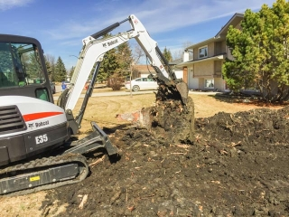 Stump removal with excavator