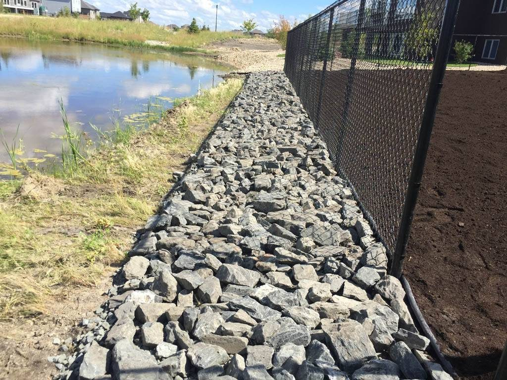 4-8 inch black granite along lake edge