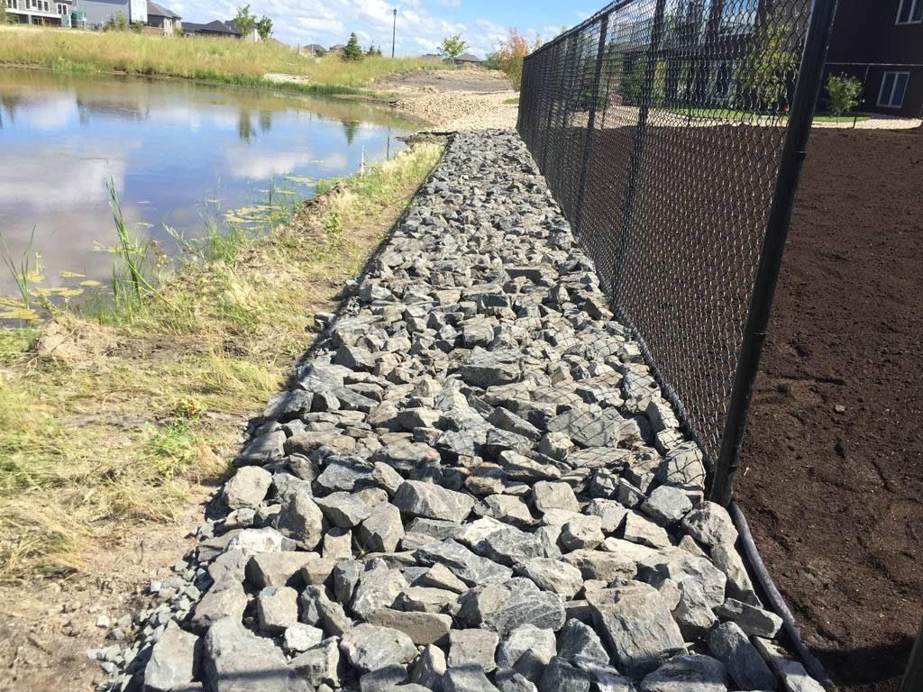 4-8 inch black granite along lake edge (rock gardens)
