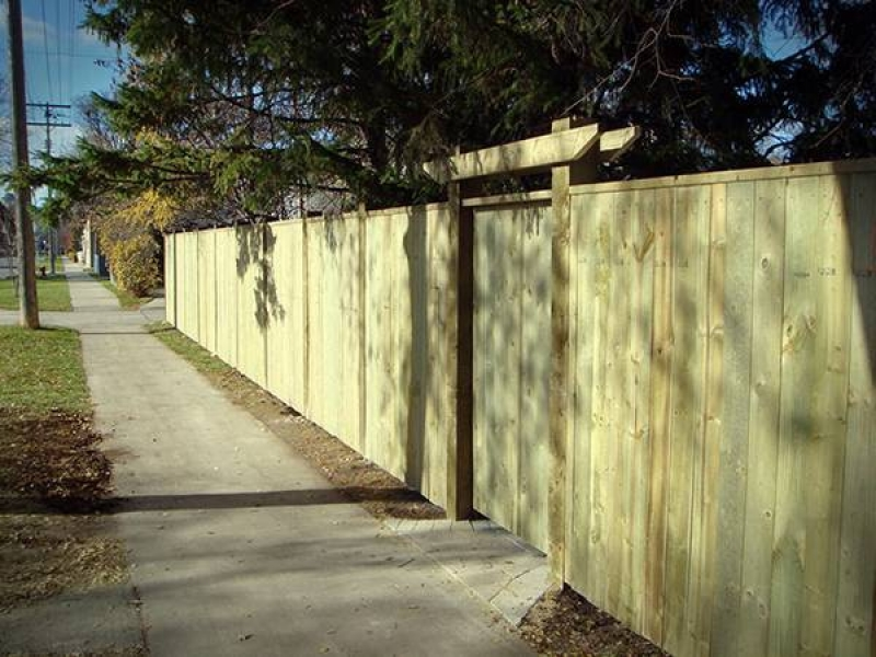 6ft treated green fence with crossbar over gate and 6x6 posts (fences)