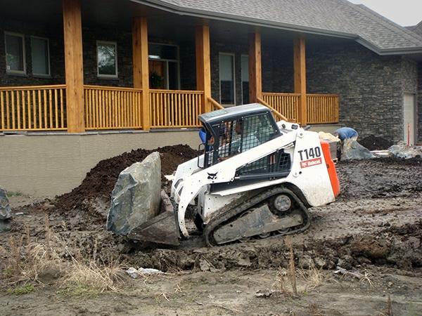 Complete Yard Installation Black Granite Boulders Brown