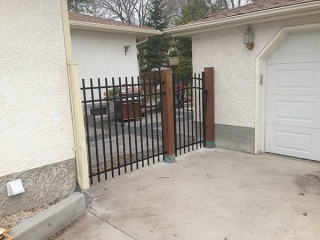 Black ornamental fence and gate with treated brown 6x6 posts (fences)