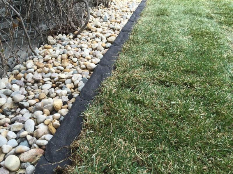 Charcoal Granite Edger separating grass and riverwash