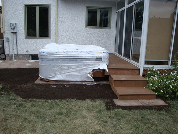 Composite deck with adjoining hot tub (decks).jpg