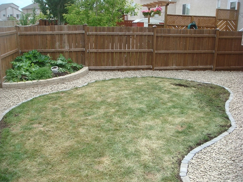 Crushed stone separated from existing lawn by I con edger