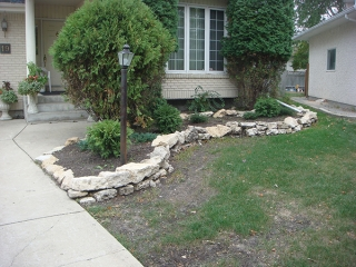 Backyard oasis with bridge, dry stream, dry waterfall, shed patio and deck