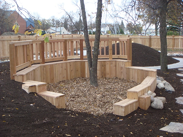 Daycare Playground Enclosed By Cedar Fence Shelter With