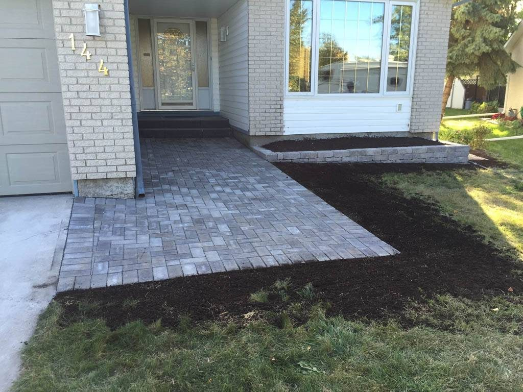 Holland front walk with Quarry Stone planter