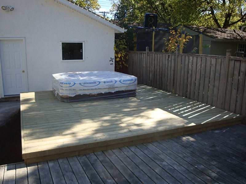 Hot tub pad and treated green deck added to existing deck